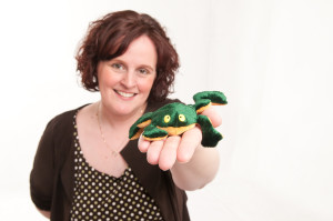Woman holding a toy frog
